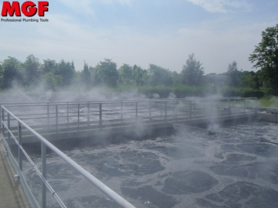 Odor control and dust reduction by high pressure misting